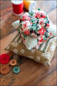 """""""Pins and Needles Pincushions."""" Web Bonus for quilt featured in Quilt Almanac 2011 by Elaine Sexton. Fabric used was from the Antique Treasures collection from Fabri-Quilt, Inc."""