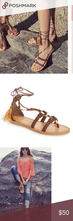 Dolce Vita Jinny Sandal - Bohemian Style Brand new in box. Perfectly on trend! Burnished goldtone hardware and braided leather straps enhance the bohemian appeal of this slim-soled sandal fashioned with slender laces that tie around the ankle for a perfect fit.Ideal for day-to-evening wear, this warm-weather style is finished with a pair of tassels Leather upper/synthetic lining and sole. To achieve a look that wraps up the leg, cross straps around back of ankle and twist; then bring straps…