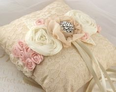 Dainty pillow with fabric roses.  I adore the brooch pinned in the center!
