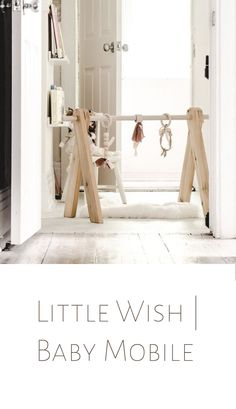Little Wish | Baby Mobile A simple but striking design made entirely of solid wood. Perfect for a Montessori-inspired or minimalist household, this mobile is for those searching for an all natural piece to engage your baby and compliment your home.