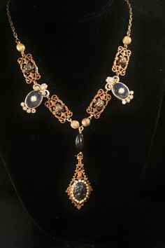 Victorian style necklace using vintage 50's glass cabochons, vintage earrings and new filigree connectors. Available at The Phunky Phoenix, Llano, TX.