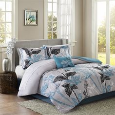 Claremont makes a bold fashion statement in your bedroom. A large scale bright aqua and black floral print covers this gray comforter. The reverse is a solid bright aqua. Two standard shams and one bright aqua decorative pillow add another dramatic pop to this comforter set. A black and white sheet set completes the look.