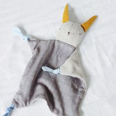 """Snuggly, sweet, easy-to-hold, with different textures and plenty of chewy knots for teething. Made from soft and nubbly French terry """"fur"""" on one side and a smooth polka dot muslin belly, this adorabl"""