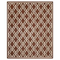 Bring eye-catching appeal to your home with this wool rug showcasing an overlapping quatrefoil ogee motif. Hand-tufted in India.  P...