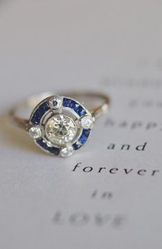Love the design of this unique sapphire engagement ring - reminds me of a compass