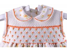 …Bullion roses on the smocking to match the floral print ~