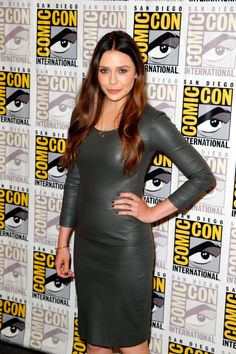 """Elizabeth Olsen attends Marvel's Hall H Press Line for """"Ant-Man"""" and """"Avengers: Age Of Ultron"""" during Comic-Con International 2014 at San Diego Convention Center on July 26, 2014 in San Diego, California."""