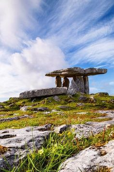 Cirrus clouds dapple the skies above Poulnabrone Dolmen, County Clare. A portal tomb dating back to the Late Stone Age, the name Poulnabrone means 'the hole of sorrows' in Irish.