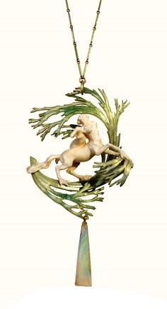 René Lalique.  'Rape of Deianira' Pendant c. 1900 - 1902. Pendant whose motive is a sculptural group in ivory representing Nessus and Deianira. The monster paws end in membranes based on algae in enamelled gold in shades of green surrounding the two figures. Algae hangs an oblong opal triangular shape with traces of the array. Wire small bars of square section in enamelled gold green.