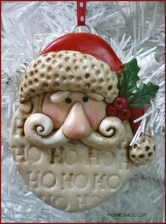 I created this Santa ornament from Ultra Light polymer Clay (the white portions). I stamped his beard with Ho Ho Hoover & over and textured