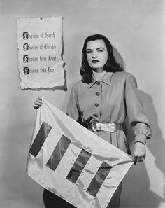 Actress Ella Raines diplays the Four Freedoms