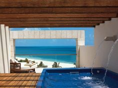 Just 30 minutes north of Cancún proper, this pristine, peaceful resort features seven swimming pools and access to an oceanfront Greg Norman–designed golf course. Opt for a suite with its own spacious rooftop terrace and private heated HydroSpa pool