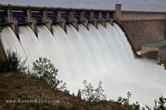 Dam at lake...pass over this all the time. / It makes the news in SW Missouri when all flood gates are opened because it does not occur often.  Gates are usually open for only a few days too. Branson, Missouri.