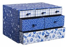 Accessorise your workspace with this gorgeous China Blue multi drawer unit. Perfect for storing all of your bits and pieces from jewellery to stationery and a stylish way to keep your desk organised! Features a pretty floral and bird design with 6 blue lined drawers (1 large, 2 medium and 3 small) each with a different fronted design, all have blue ribbon pulls. The small drawers have a blue gingham design on a white background, the medium drawers have a white lined design on a blue…