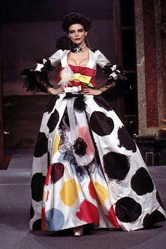 In the fall of 1995, Westwood came out with the Vive La Cocoette range. All of the dresses in the range were bright, chest-hugging and large-bottomed. The collection it's self was inspired by Victorian French fashion, and it features exaggerated silhouettes, shocking colour clashes and high heels. That being said, some of the dresses in this collection were very simple, yet terribly overstated. It featured a knitted dress, dyed a horrific lavender colour.