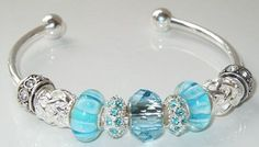 Interchangeable Pandora-style large hole beads on a cuff bracelet features a gorgeous aquamarine Swarovski crystal focal bead.