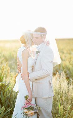 bride + groom in veil // photo by Mallory Morgan Photography // http://ruffledblog.com/west-texas-cornfield-wedding