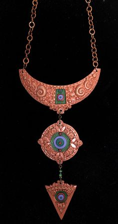 Copper resin/clay necklace by labeanabags, via Flickr