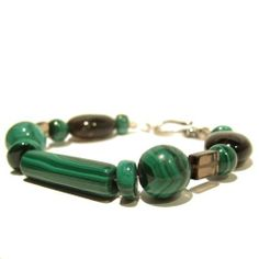 "Malachite Bracelet 06 Strand Smoky Quartz Green Brown Silver Gemstone Crystal Healing Beaded I Dig Crystals. $65.00. Art Jewelry: natural malachite and smokyquartz gemstone bracelet. Stone Properties: Malachite releases emotional trauma; Smoky Quartz helps grounding. One-of-Kind: handmade gifts by I Dig Crystals are made in the USA. Measures: approx 6.7""L x 8-16mm (may be resized upon request). Chakra Balancing: Heart, Root"