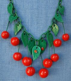 Love this faux bakelite necklace. Ladybirds!