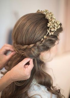 Half flower crown with braid and hair tucked into the braid for an updo
