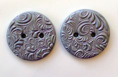 Beautiful handmade polymer clay buttons with a swirling raised texture and a lovely sparkly to catch your attention. Sew these buttons to your