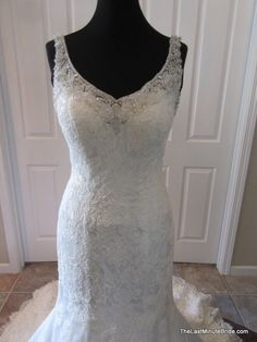 Description Essense of Australia Wedding Dress Style D1665 Fit and flare lace bridal gown with a Diamante crystal embellished b-neckline and delicate sheer straps. The back of the dress features a low