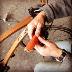 Animus bike made with red cedar wood and carbon layers