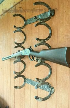 Horseshoe gun rack...recommend Plastidip to prevent scratches to your rifles and shotguns.