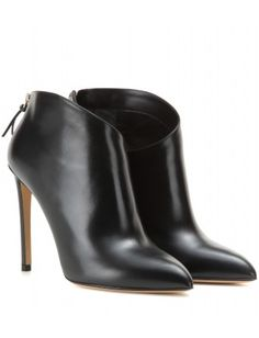 Francesco Russo - mytheresa.com exclusive leather ankle boots - An asymmetric design renders a sleek silhouette, while the smooth black leather and super-skinny heel only serve to augment the signature dose of sultriness. These are a feminine investment to last for many seasons to come - @ www.mytheresa.com