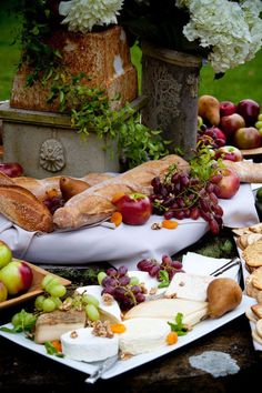 table with cheese, bread, fruit and crackers