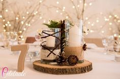 Rustic wood table centres from a wedding in France, by Celebrate Agency
