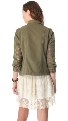 love the studs on this army jacket and the dress underneath
