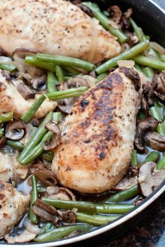Green Bean and Mushroom Braised Chicken w brown rice/quinoa: 4 boneless chicken breasts  1 large white onion, sliced thin  1 shallot, minced  3 garlic cloves, minced  2 lbs green beans, trimmed and halved  1 1/2 lbs of crimini mushrooms, sliced  1 1/2 cups of beef stock (or chicken, whatever you have)*  1 + 1/2 tablespoon olive oil  salt and pepper  1/3 cup flour