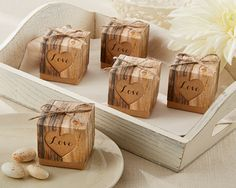 Hearts Rustic Favor Box - Reminiscent of a legendary tradition--carving true love's initials on a tree! Fill the boxes with something sweet, and you've made your future complete. #WeddingDresses #WeddingRings #WeddingGifts #Wedding #WeddingIdeas