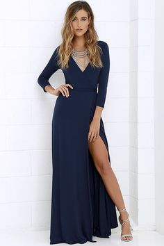 Stroll along tree-lined lanes, with a glass of ice tea and the Garden District Navy Blue Wrap Maxi Dress flowing in the breeze! Lightweight jersey knit forms this three-quarter sleeve stunner with a wrapping surplice bodice, and tying sash at the waist. Wrapped detail carries into a front slit maxi skirt for a sensational finish.