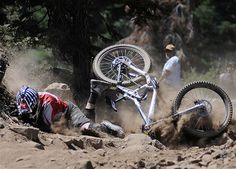 A rider crashes near the finish line during a downhill mountain bike race event in Truckee, Calif