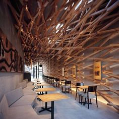 Architects Kengo Kuma and Associates have installed a Starbucks coffee shop on the approach to a Shinto shrine in Dazaifu, Japan.Over 2000 wooden batons line the interior of the shop, creating a diagonally woven lattice that spikes out beyond the recessed glass facade.