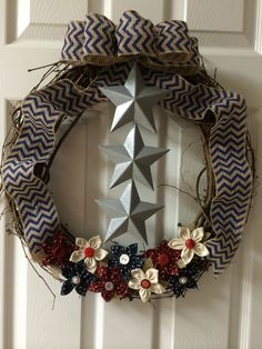 3 star with blue chevron burlap ribbon and red, white & blue handmade flowers.  http://dreamininburlap.wix.com/dreaminwreaths