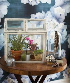 Reminiscent of the large, enclosed terrariums that were popular in the Victorian era, this sweet DIY creation is essentially a mini greenhouse in which hothouse plants like ferns and orchids can thrive throughout the year. Country Living offers a step-by-step tutorial for making it out of eight picture frames.