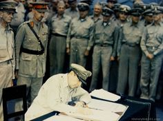 General of the Army Douglas MacArthur signs the Surrender Document with Japan, in behalf of all the United Nations