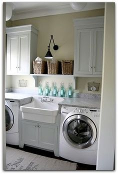 Laundry room : a sink in between and storage above.
