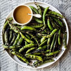 Grilled Sugar Snap Peas With Spicy Peanut Dipping Sauce via feedfeed on https://thefeedfeed.com/farm-fresh/andreabemis/grilled-sugar-snap-peas-with-spicy-peanut-dipping-sauce