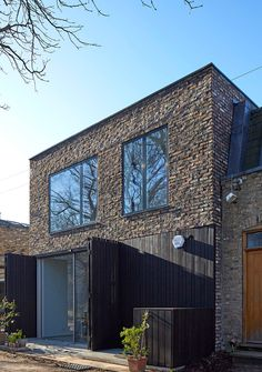 SAM Architects uses recycled brick and charred wood for London mews house Brick And Wood, Brick Walls, Dark Wood, Recycled Brick, Mews House, Charred Wood, Brick Architecture, Timber Cladding, Garden Studio