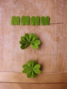 Felt shamrocks: There is no tutorial here, but the picture is pretty self-explanatory. Once you have a bunch of these felt shamrocks finished, you can create a variety of garlands or hanging decorations with them. If you don't want to hang them, you can use them as small decorations on tables or bookshelves or on the mantel. Would be cuts as little lapel pins!