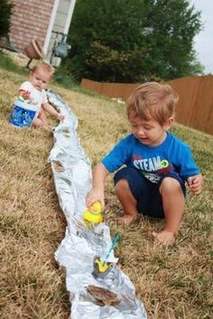 Outdoor summer fun on the steep decline of the backyard. Make our own river.
