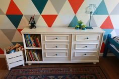 Materials: Ikea Rast drawers  Description: Screw two Rast chest of drawers together, add some timber or MDF, decorate with molding and give extra legs. Voil