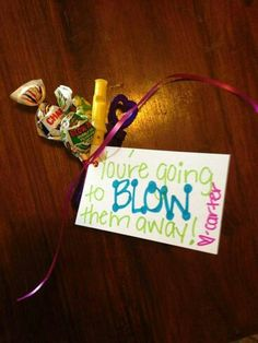 Dance / cheer goody bag idea - Blow pops, mini player flute, and bubbles! Cheer Treats, Cheer Gifts, Cheer Mom, Diy Gifts, Camp Gifts, Gymnastics Gifts, Cheerleading Gifts, Volleyball Gifts, Basketball Gifts