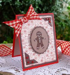 gingerbread man with corners & bow  red white and brown