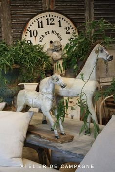 Privitive Needul Things...white chipped horses...weathered blue table shutters...rusty clock...Angel.